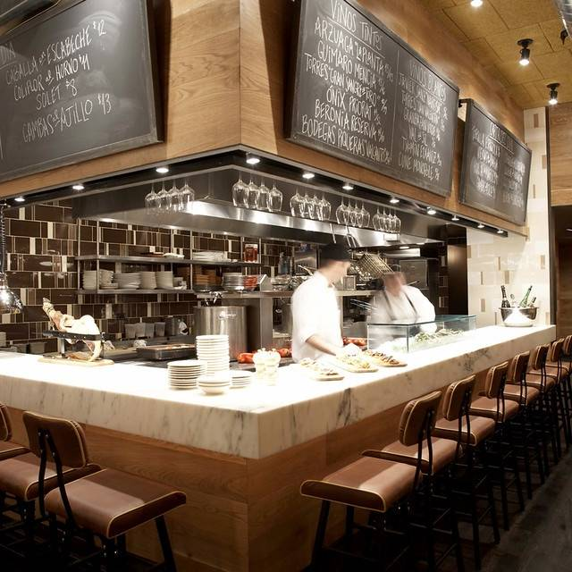 Open Kitchen With Bar Counter Seating And Chefs At Work: Boqueria Soho - New York, NY