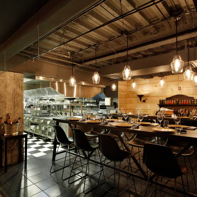 Open Kitchen With Bar Counter Seating And Chefs At Work: Black Barn Chef's Table Restaurant - New York,