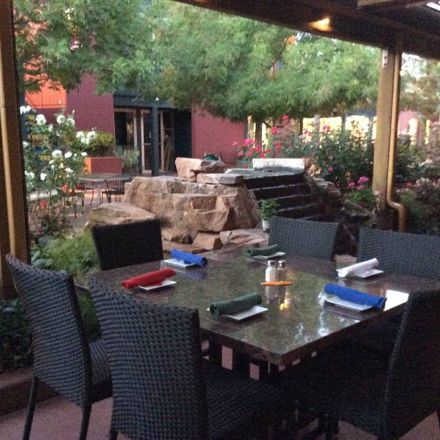 Garden Patio with water feature. - HP Cafe America Bistro, Sedona, AZ