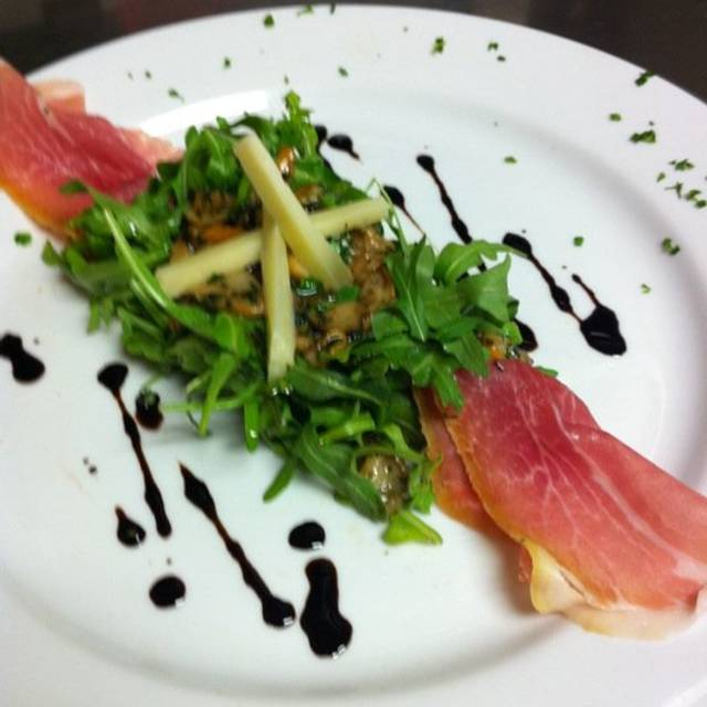 Arugula Salad Topping With Porcini Mushroom Prosciutto Di Parma And Asiago Cheese - Cafe Amici, Sarasota, FL