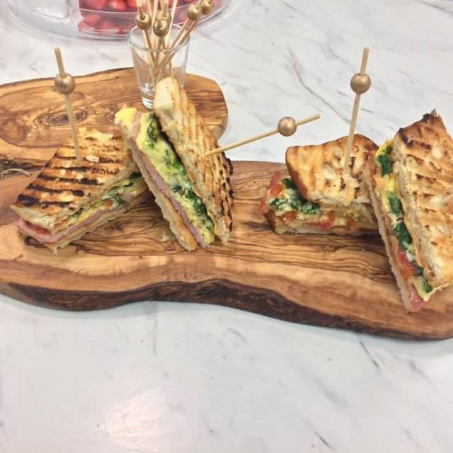 Our Breakfast Sandwiches Sliced - 7 & 7 Coffee & Wine House, Ocala, FL