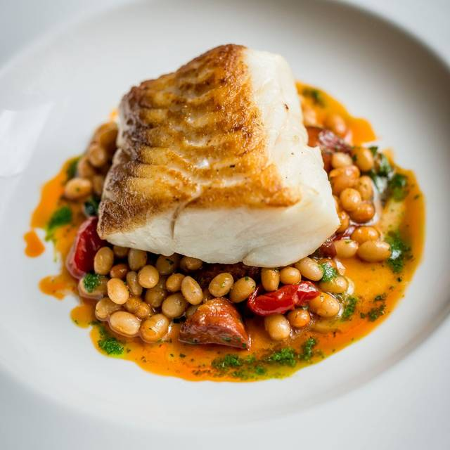 The Ivy Fillet Of Cod, Braised Coco Beans, Chorizo & Smoked Paprika Oil By David Griffen - The Ivy Dining Counter, London