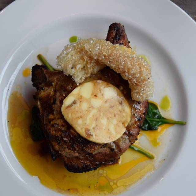 G Pork Chop With Salt And Pepper Crackling And Homemade Paprika Butter - Photo By Simon Burrell - The Jones Family Project, London