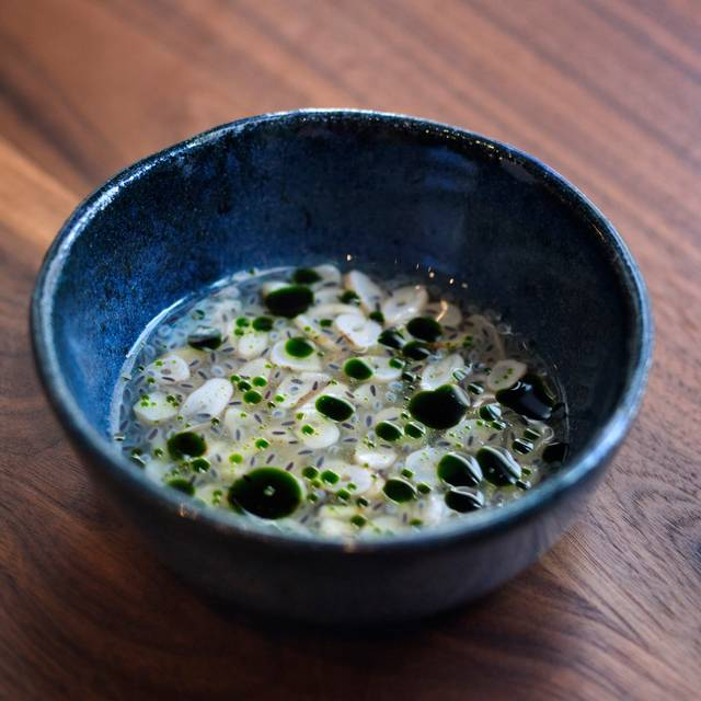 Razor-clam-pineapple-basil-credit-gabriele-stabile- - Momofuku Ko - Table Seating, New York, NY
