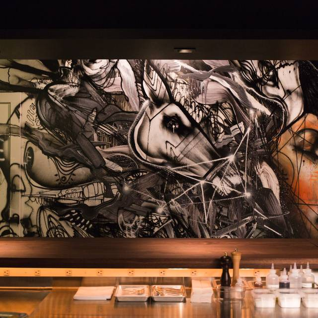 Momofuku-ko-interior-with-artwork-by-david-choe-photo-credit-gabriele-stabile - Momofuku Ko - Table Seating, New York, NY