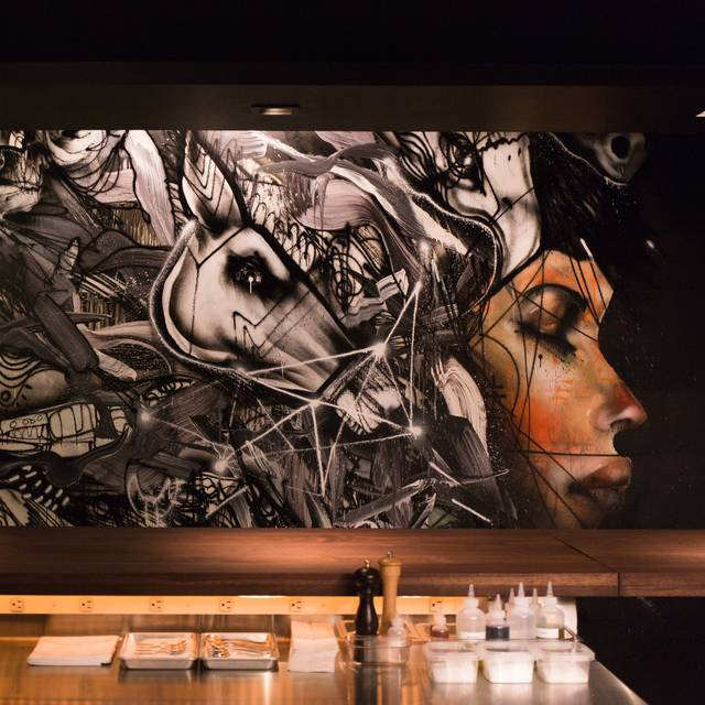 Momofuku-ko-interior-with-artwork-by-david-choe-photo-credit-gabriele-stabile - Momofuku Ko - Counter Seating, New York, NY