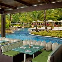 photo of seagrapes restaurant - st. regis bahia beach hotel restaurant