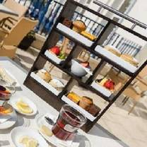 photo of afternoon tea at hotel de france restaurant