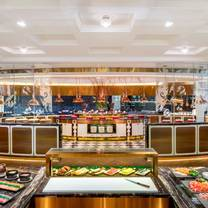 photo of rain tree cafe - the athenee hotel, a luxury collection hotel bangkok restaurant