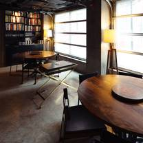photo of momofuku ko - table seating restaurant