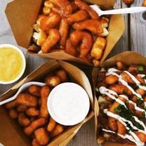 photo of montreal hotdogs poutine & fries restaurant