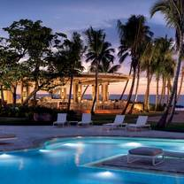photo of encanto beach club bar & grill - dorado beach a ritz-carlton reserve restaurant
