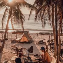 foto de restaurante beach club papaya playa