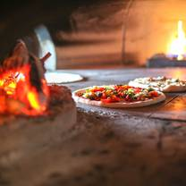 photo of twin oak wood fired pizza & bbq restaurant