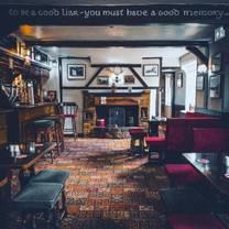 photo of the woodman inn & quality carvery restaurant restaurant