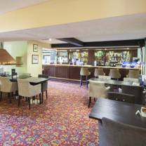 photo of highwayman's bar and lounge @ the holt hotel restaurant