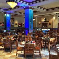 photo of trattoria del porto at loews portofino bay hotel restaurant