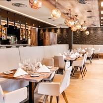foto von cafe schweizerhof - mountain spa residences restaurant
