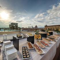 photo of empireo - rooftop & pool american bar by hotel lucchesi restaurant