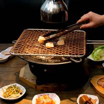 photo of hwaro korean bbq restaurant restaurant