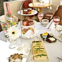 photo of afternoon tea at la mon hotel and country club restaurant
