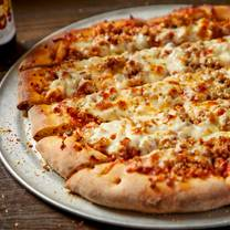 photo of roots handmade pizza - second city restaurant