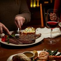 photo of the keg steakhouse + bar - crowfoot restaurant