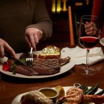 photo of the keg steakhouse + bar - market mall restaurant