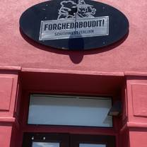 photo of forghedaboudit pizza restaurant