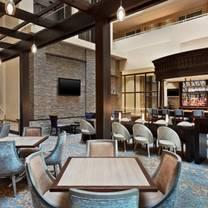 photo of amuse kitchen + cocktails at the embassy suites hilton boston waltham restaurant
