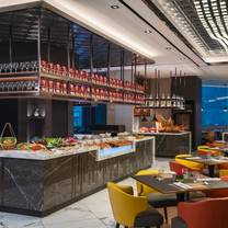 photo of evolution café - renaissance kuala lumpur hotel restaurant